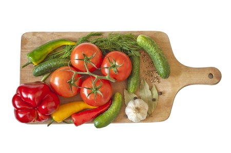Vegetables and spices isolated on kitchen board  photo