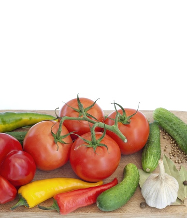 Vegetables and spices on kitchen cutting board  photo