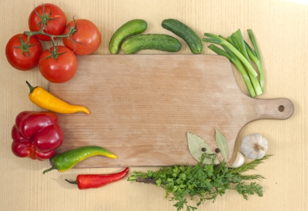 vegetables and spices border and empty cutting board  photo