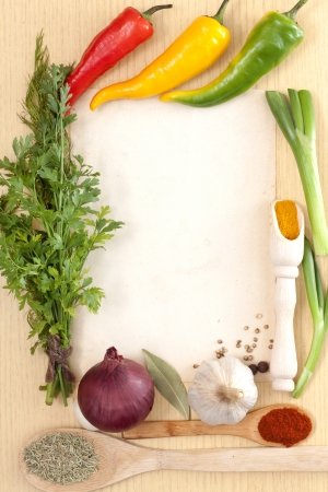 Vegetables and spices border and blank paper for recipes photo