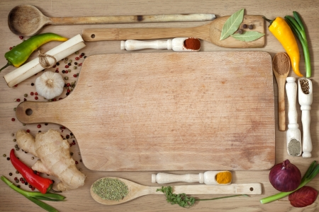recipe book:  vegetables and spices border and empty cutting board