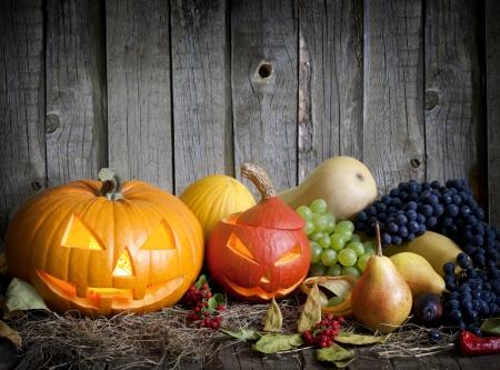 halloween concept:  Halloween pumpkins fruits and vegetables autumn still life Stock Photo