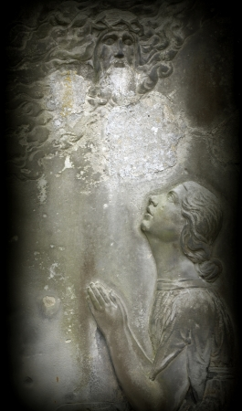 Angel on tombstone on old cemetery photo