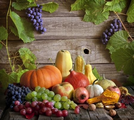 Fruits and vegetables with pumpkins in autumn still life photo