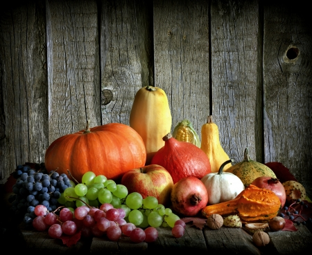 Fruits and vegetables with pumpkins in autumn vintage still life photo