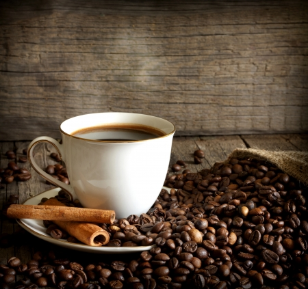 Cup of coffee with beans and cinnamon vintage still life Stock Photo - 15631323