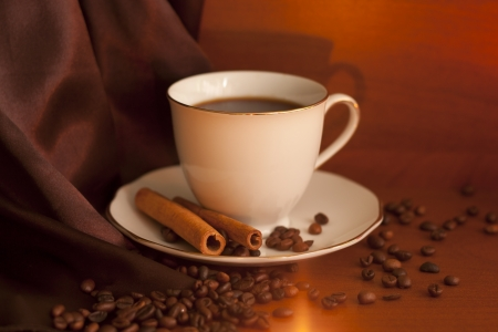 Cup of coffee with cinnamon and beans photo