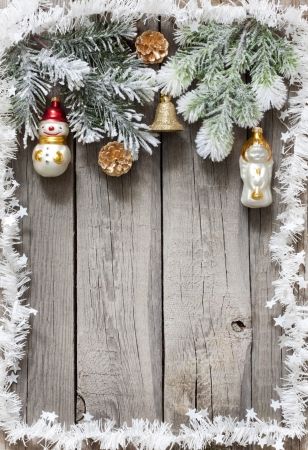 xmas background: Christmas tree baubles background on vintage wooden boards
