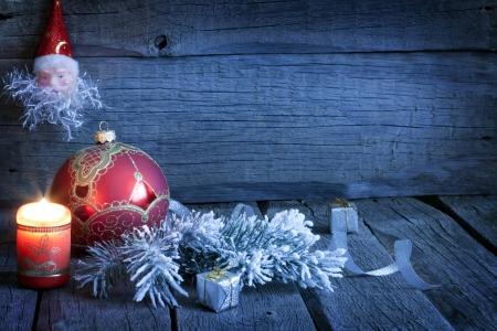 Christmas vintage background with candle and bauble in night Stock Photo - 15685537