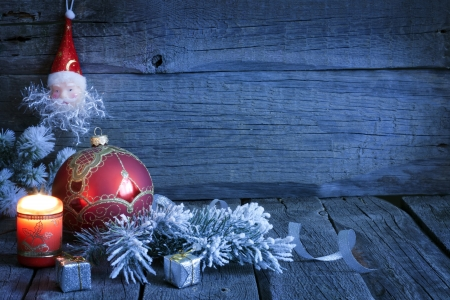 Christmas vintage background with candle and bauble in night Stock Photo - 15685538