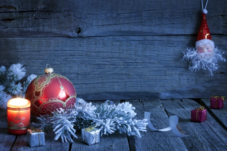 Christmas vintage background with candle and bauble in night Stock Photo - 15685540
