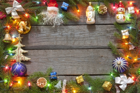 Christmas background border with baubles and lights photo