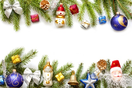 group of christmas baubles:  Christmas background border with fir and baubles on white Stock Photo