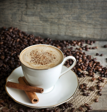 Cappuccino and coffee beans vintage still life on wooden boards Stock Photo - 15843553