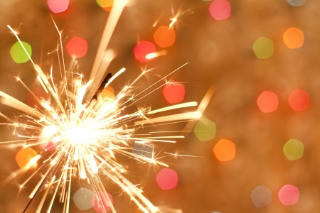 sparkler: Sparkler and colorful bokeh christmas new year background  Stock Photo