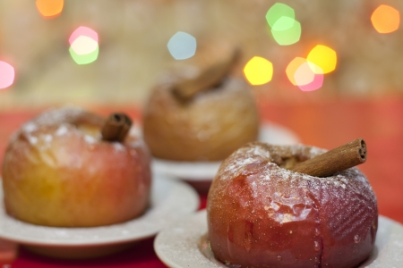 Christmas food baked apples closeup and blurred background  photo