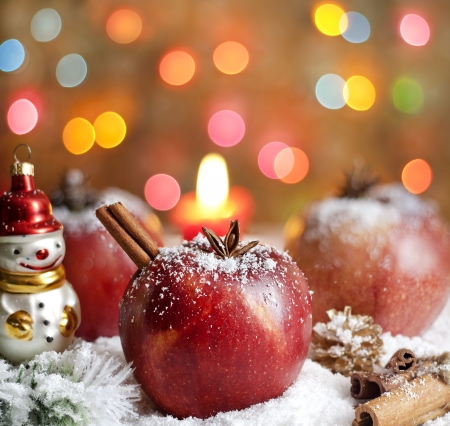 Christmas food apples on snow closeup and blurred background photo