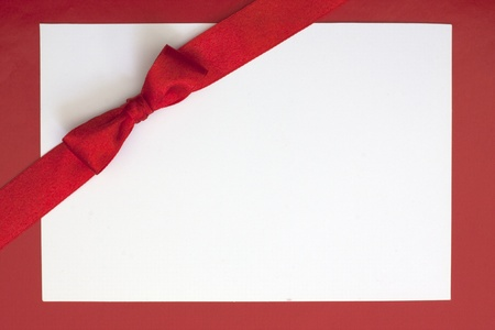 corner ribbon: Christmas sheet of paper and red ribbon gift background Stock Photo