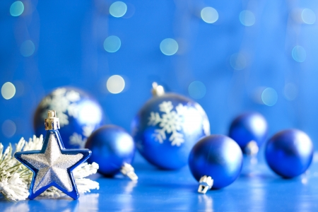 Christmas star closeup and baubles on blue blurred background photo