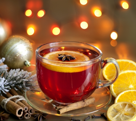 Christmas drink punch and spices on colorful background  photo