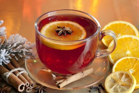 star of life: Christmas drink punch and spices on colorful background