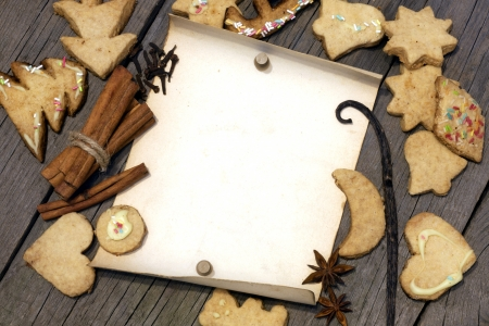 Christmas cookies and old vintage blank paper on wooden boards photo