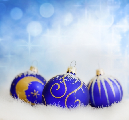 Christmas blue baubles on abstract blurred background closeup photo