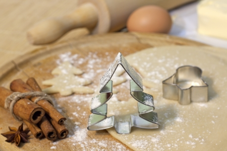 christmas motif: Christmas baking cookies with tree shape on blurred background Stock Photo