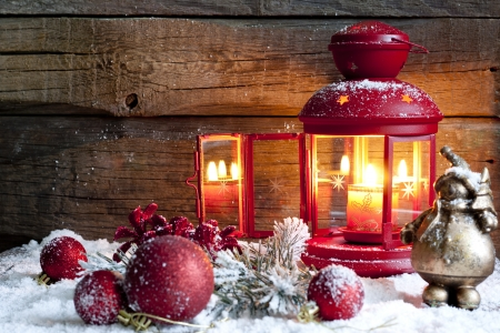 advent: Christmas baubles and lantern in night vintage background