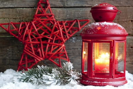Christmas red star and lantern in night on snow with fir  photo