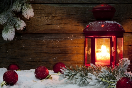 candlelight: Christmas lantern in night on snow with baubles background  Stock Photo