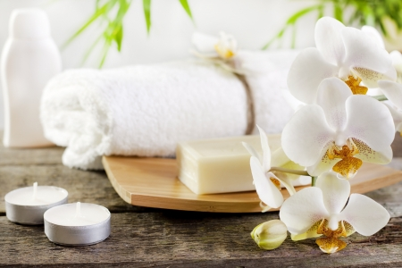 Orchids spa soap and towel concept on wooden boards  photo