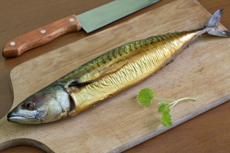 Smoked mackerel on the table photo