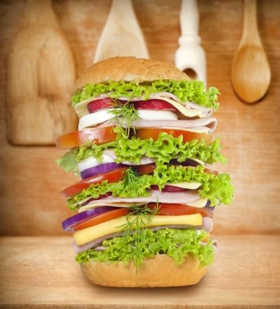 Sandwich very big on vintage wooden boards photo