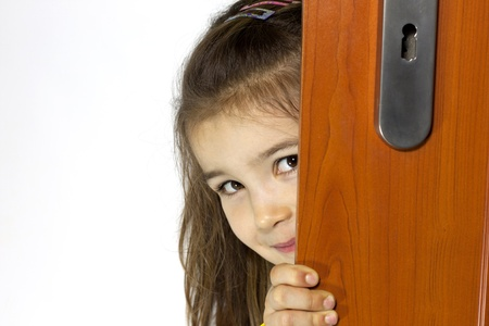 Girl opening the door and mysterious smiling photo
