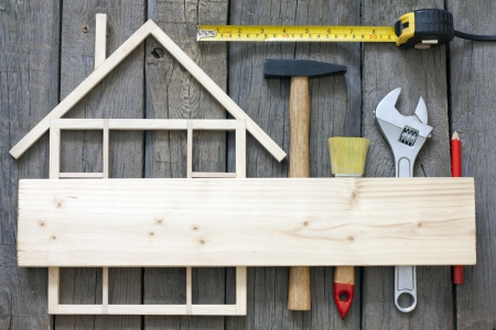Wooden house construction renovation and tools background photo