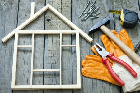 home renovations: House construction renovation abstract background and tools Stock Photo
