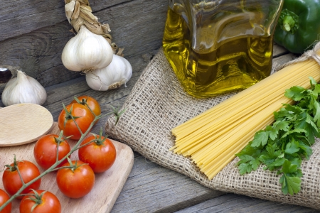 Pasta spaghetti and spices on vintage wooden boards photo