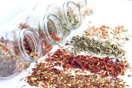 Dried spices in jar on white background closeup Stock Photo - 16910195