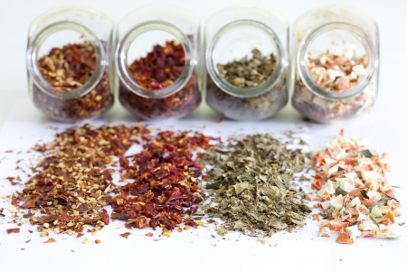 Dried spices in jar on white background closeup photo