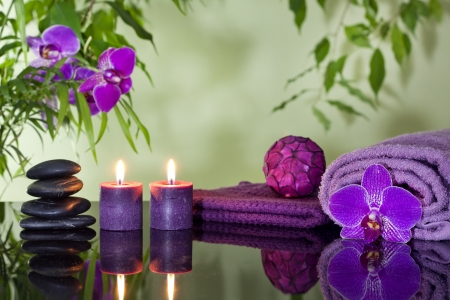 Zen stones orchid aromatic candles and towel spa concept  photo