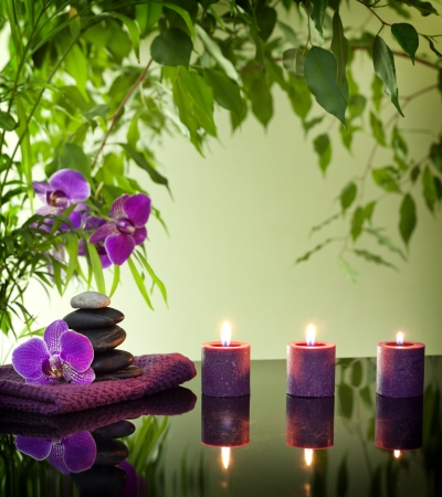 Spa still life with zen stones aromatic candles and orchids Stock Photo