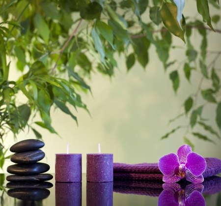 Spa still life with zen stones aromatic candles and orchids Stock Photo - 17092395