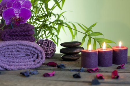 candles spa: Spa still life with zen stones aromatic candles and orchids Stock Photo