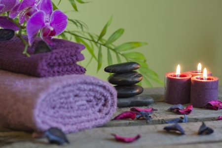 mind body spirit: Spa still life with zen stones aromatic candles and orchids Stock Photo