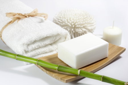 spa still life: Towel and spa soap on white background Stock Photo