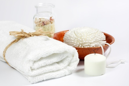 towels luxury: Towel and sponge spa bath concept on white background