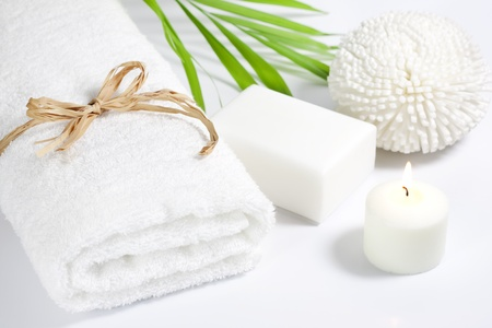 Towel and sponge spa bath concept on white background photo