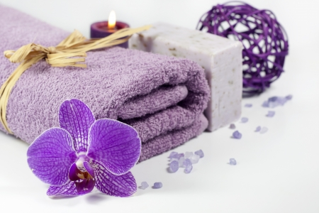 Orchid and towel spa concept with bath salt photo