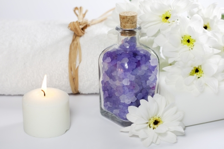 Bath salt and towel spa cosmetic concept photo